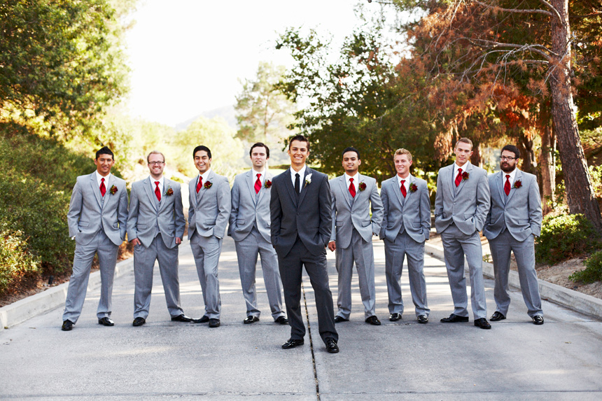 Groom in black tux and groomsmen in gray?